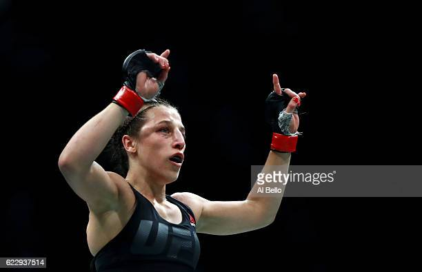 Joanna Jedrzejczyk of Poland celebrates her victory over Karolina Kowalkiewicz of Poland in their women's strawweight championship bout during the...