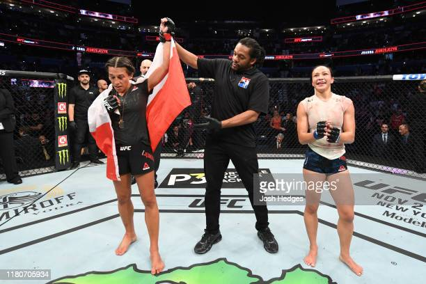 Joanna Jedrzejczyk of Poland celebrates her victory over Michelle Waterson in their women's strawweight bout during the UFC Fight Night event at...