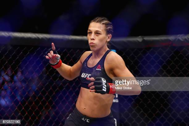 Joanna Jedrzejczyk of Poland enters the ring for her UFC women's strawweight championship bout against Rose Namajunas during the UFC 217 event at...