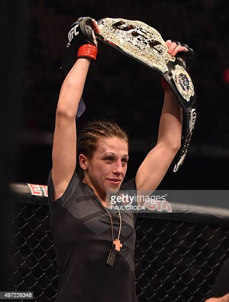 Joanna Jedrzejczyk of Poland holds up the UFC Strawweight title belt after beating Valerie Letourneau of Canada in Melbourne on November 15 2015...
