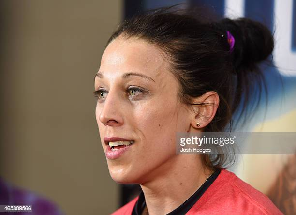 Joanna Jedrzejczyk of Poland interacts with media after an open training session for fans and media at the Hilton Anatole Hotel on March 11 2015 in...