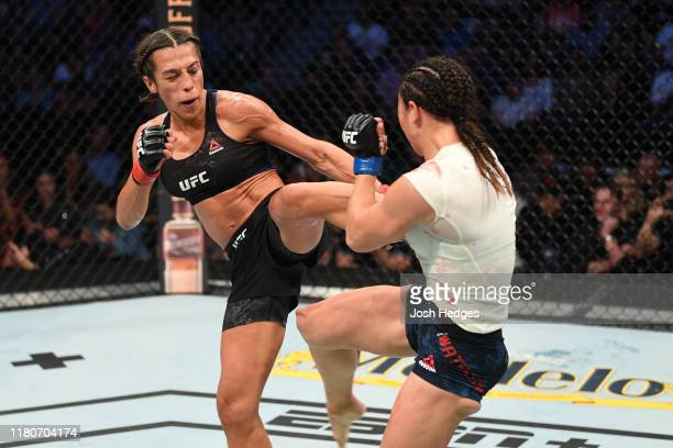 Joanna Jedrzejczyk of Poland kicks Michelle Waterson in their women's strawweight bout during the UFC Fight Night event at Amalie Arena on October 12...