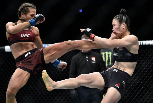 Joanna Jedrzejczyk of Poland kicks Zhang Weili of China in their UFC strawweight championship fight during the UFC 248 event at T-Mobile Arena on...