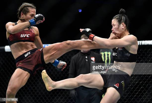 Joanna Jedrzejczyk of Poland kicks Zhang Weili of China in their UFC strawweight championship fight during the UFC 248 event at TMobile Arena on...