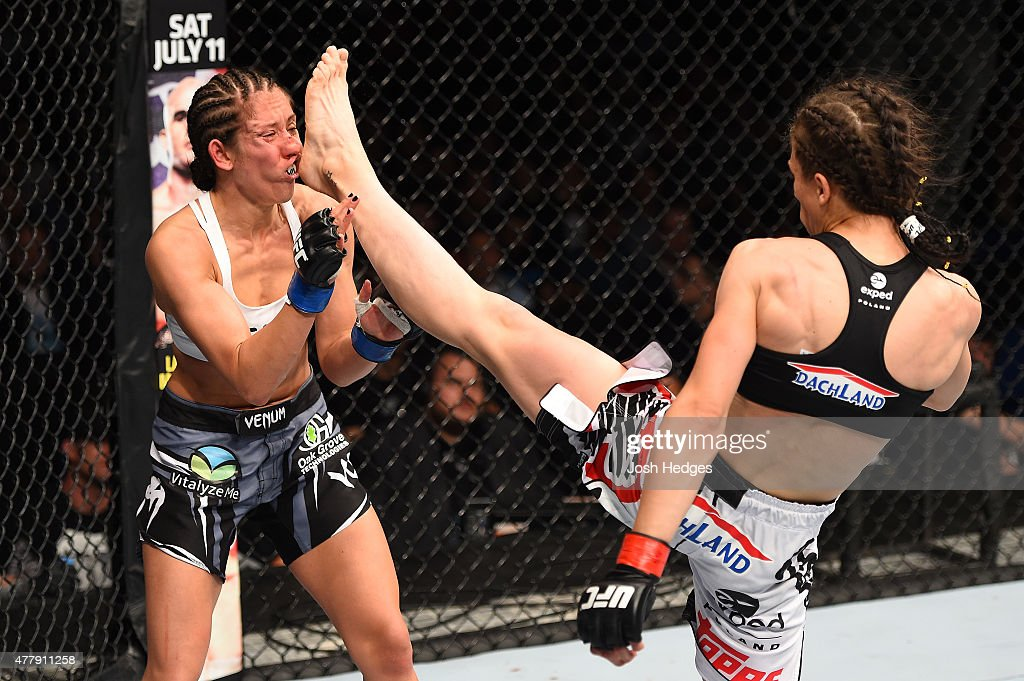 Joanna Jedrzejczyk of Poland lands a front kick against Jessica Penne of the United States in their women's strawweight championship bout during the UFC Fight Night event at the O2 World on June 20, 2015 in Berlin, Germany.