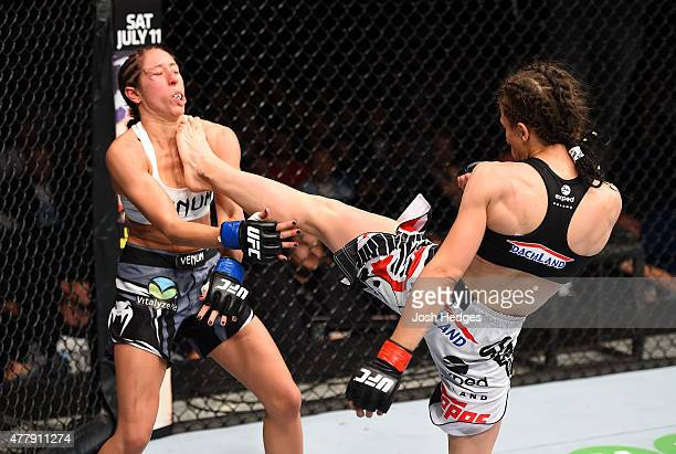 Joanna Jedrzejczyk of Poland lands a front kick against Jessica Penne of the United States in their women's strawweight championship bout during the...