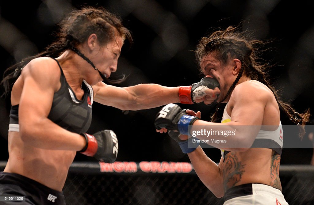 Joanna Jedrzejczyk of Poland punches Claudia Gadelha of Brazil in their women's strawweight championship bout during The Ultimate Fighter Finale event at MGM Grand Garden Arena on July 8, 2016 in Las Vegas, Nevada.