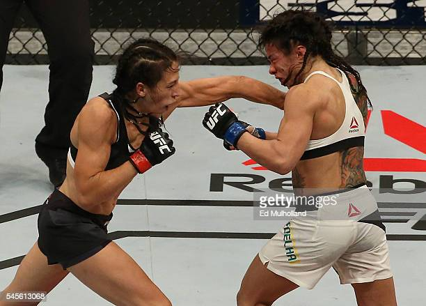 Joanna Jedrzejczyk of Poland punches Claudia Gadelha of Brazil in their UFC women's strawweight championship bout during The Ultimate Fighter Finale...