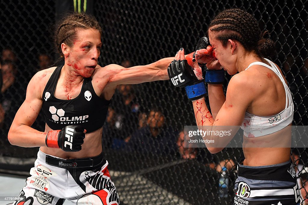 Joanna Jedrzejczyk of Poland punches Jessica Penne of the United States in their women's strawweight championship bout during the UFC Fight Night event at the O2 World on June 20, 2015 in Berlin, Germany.