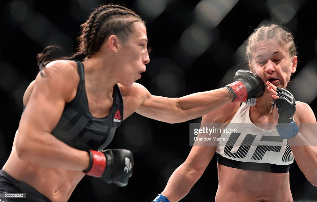 Joanna Jedrzejczyk of Poland punches Karolina Kowalkiewicz of Poland in their UFC women's strawweight championship fight during the UFC 205 event at Madison Square Garden on November 12, 2016 in New York City.