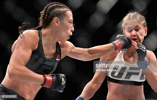 Joanna Jedrzejczyk of Poland punches Karolina Kowalkiewicz of Poland in their UFC women's strawweight championship fight during the UFC 205 event at...
