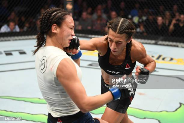 Joanna Jedrzejczyk of Poland punches Michelle Waterson in their women's strawweight bout during the UFC Fight Night event at Amalie Arena on October...