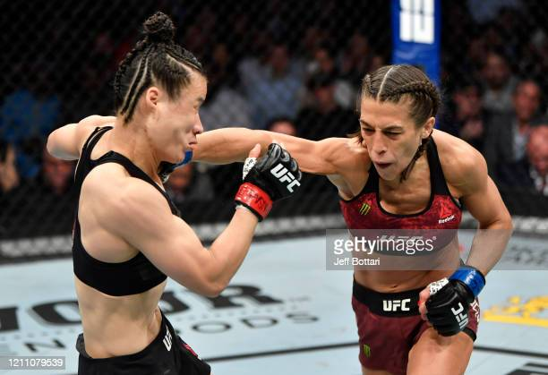 Joanna Jedrzejczyk of Poland punches Zhang Weili of China in their UFC strawweight championship fight during the UFC 248 event at TMobile Arena on...