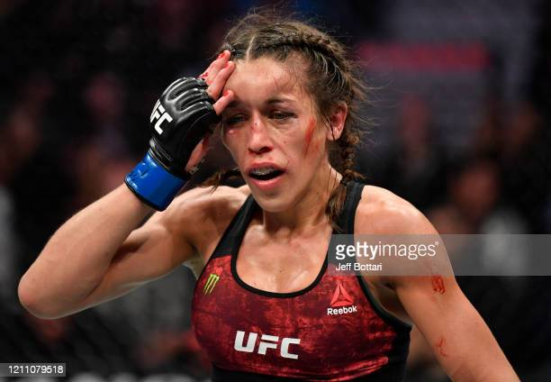 Joanna Jedrzejczyk of Poland returns to her corner after round four of her UFC strawweight championship fight against Zhang Weili of China during the...