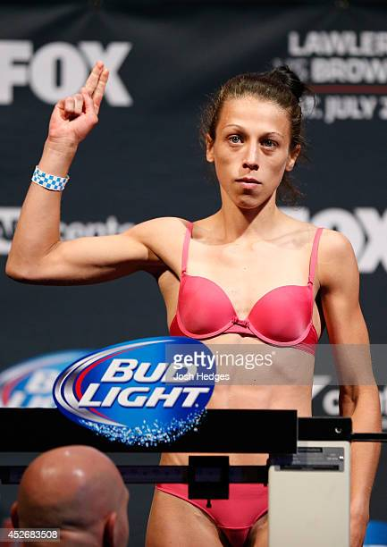 Joanna Jedrzejczyk poses on the scale after making weight during the UFC fight night weighin at the SAP Center on July 25 2014 in San Jose California