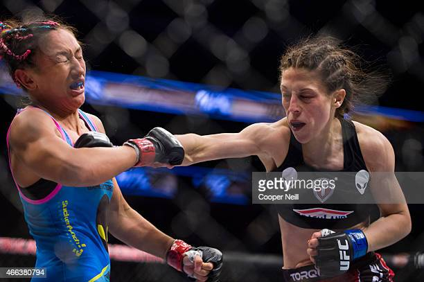 Joanna Jedrzejczyk punches Carla Esparza during UFC 185 at the American Airlines Center on March 14 2015 in Dallas Texas