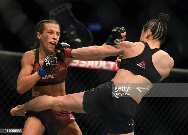 Joanna Jedrzejczyk punches Weili Zhang in a split decision loss during a strawweight title bout at TMobile Arena on March 07 2020 in Las Vegas Nevada