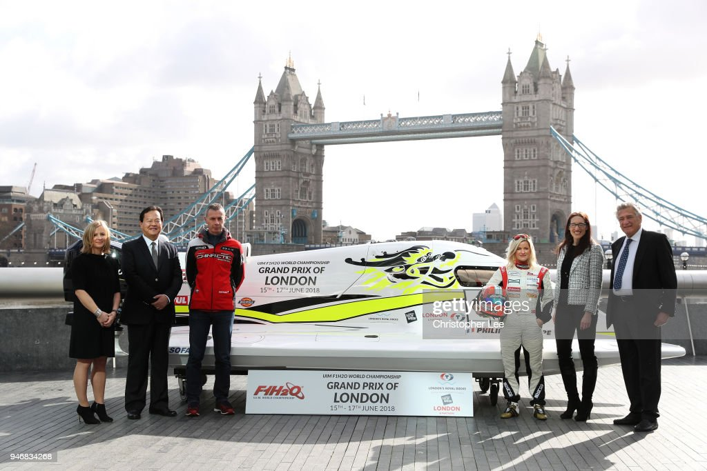 Joanna Jones, Commerical Director at London Tech Week, Mr. Li Haojie, Chairman of Tian Rong Sports, Philippe Chiappe, Professional powerboat driver, Marit Stromoy, Professional powerboat driver, Ms. Jules Chappell OBE, Managing Director, Business at London & Partners and Nicolo di San Germano, President of H2O Racing pose for a photo with the CTIC F1 Shenzhen China boat infront of Tower Bridge during the UIM F1H2O Grand Prix Of London Launch in London on April 16, 2018 in London, England.