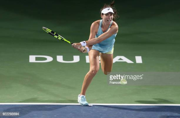 Joanna Konta of Great Britain plays a backhand against Daria Kasatkina of Russia during day three of the WTA Dubai Duty Free Tennis Championship at...