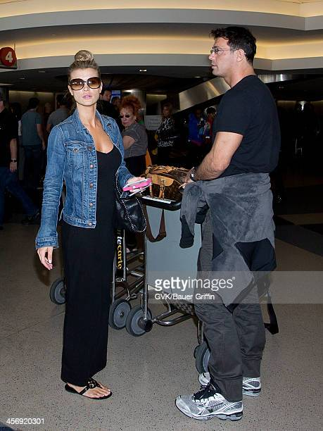 Joanna Krupa and Romain Zago are seen arriving at LAX airport on December 15 2013 in Los Angeles California