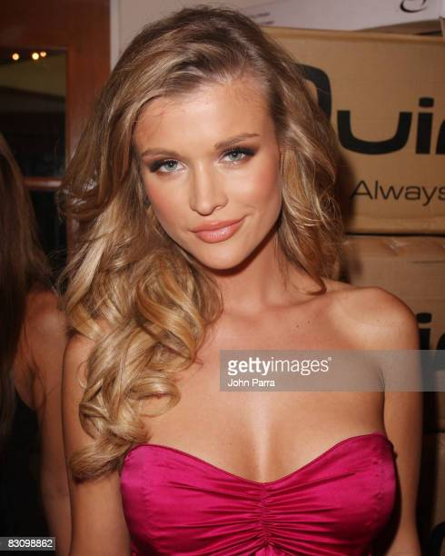 Joanna Krupa walks the runway at the Red Dress Show for the American Heart Association during Funkshion Fashion Week at Miami Beach Botanical Gardens...