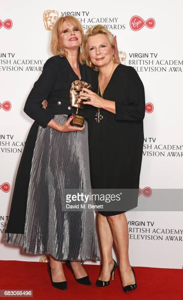 Joanna Lumley winner of the Fellowship Award and Jennifer Saunders pose in the Winner's room at the Virgin TV BAFTA Television Awards at The Royal...