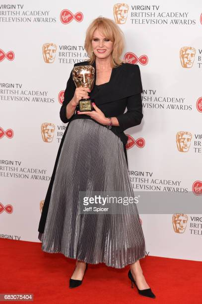 Joanna Lumley winner of the Fellowship Award poses in the Winner's room at the Virgin TV BAFTA Television Awards at The Royal Festival Hall on May 14...