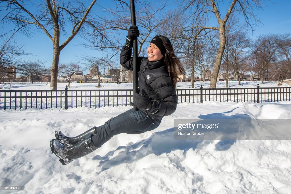 Joanna Ng-Glazier, a doctor at a local Boston hospital, rode a zip line on The Esplanade in Boston after a blizzard dropped over two feet of snow in the area, Sunday, Feb. 10, 2013.