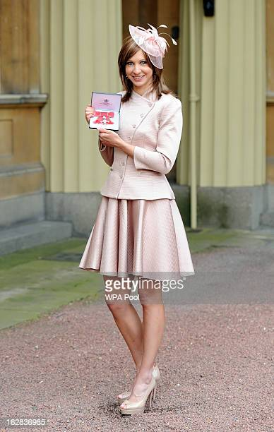 Joanna Rowsell after receiving her Member of the British Empire medal from Queen Elizabeth II during an Investiture ceremony at Buckingham Palace on...