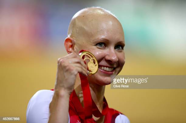 Joanna Rowsell of England poses with her Gold medal on the podium after winning the Women's 4000m Individual Pursuit Final at the Sir Chris Hoy...