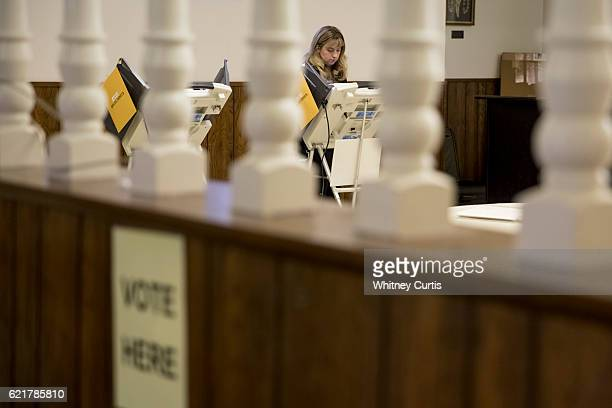 JoAnna Rush casts her ballot on November 8 2016 in Roeland Park Kansas After a contentious campaign season Americans go to the polls today to choose...