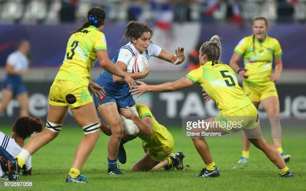Joanna Sainlo of France takes on the Australia defence during the Women's Cup semi final between Australia and France during the HSBC Paris Sevens at...