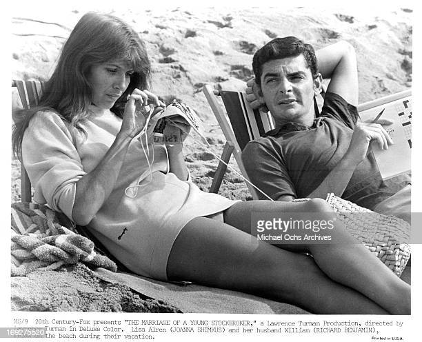 Joanna Shimkus and Richard Benjamin relax on the beach in a scene from the film 'The Marriage Of A Young Stockbroker', 1971.