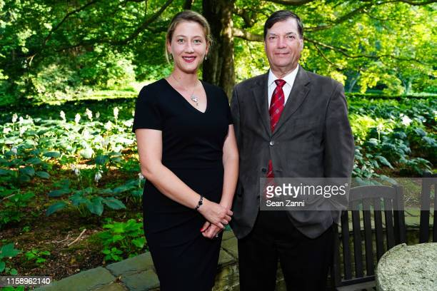 Joanna Tsue and Bob Fliegel attend A Country House Gathering To Benefit Preservation Long Island on June 28 2019 in Locust Valley New York