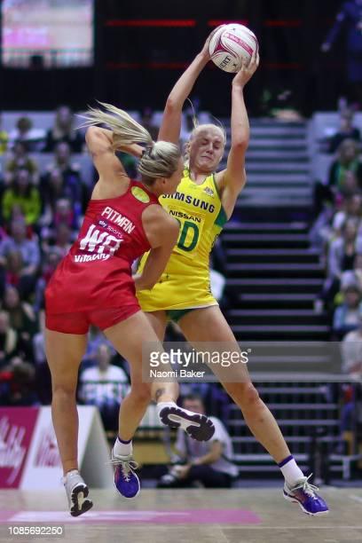 Joanna Weston of Australia catches the ball as Natalie Haythornthwaite of England looks on during the Vitality Netball International Series match...