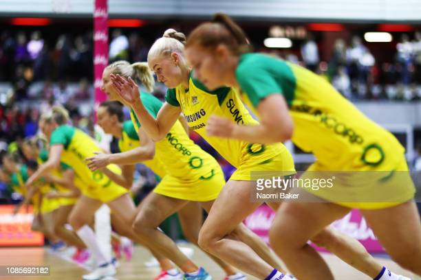 Joanna Weston of Australia warms up with her teammates ahead of the Vitality Netball International Series match between England Vitality Roses and...