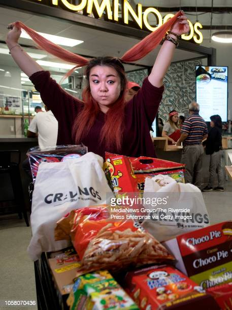 Joanna Zhang of Rowland Heights also known as food blogger monsterlovetoeat looks at her stash at Cravings Food Village an Asian food hall and...