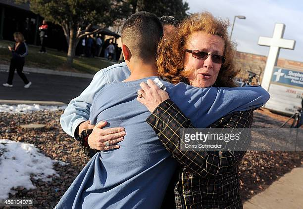 JoAnne Allen right hugs her son Alex Allen after a school shooting on December 13 2013 at Arapahoe High School in Centennial Colorado According to...