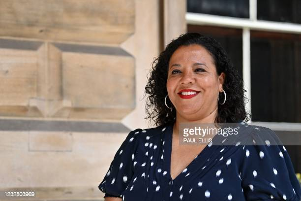 Joanne Anderson smiles as she poses for a photograph in the Town Hall in Liverpool, north-west England on May 10 after becoming Liverpool City's new...