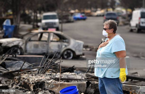 Joanne Bartlett reacts to the view of her burned home in the Coffey Park area of Santa Rosa California on October 20 2017 Residents are being allowed...