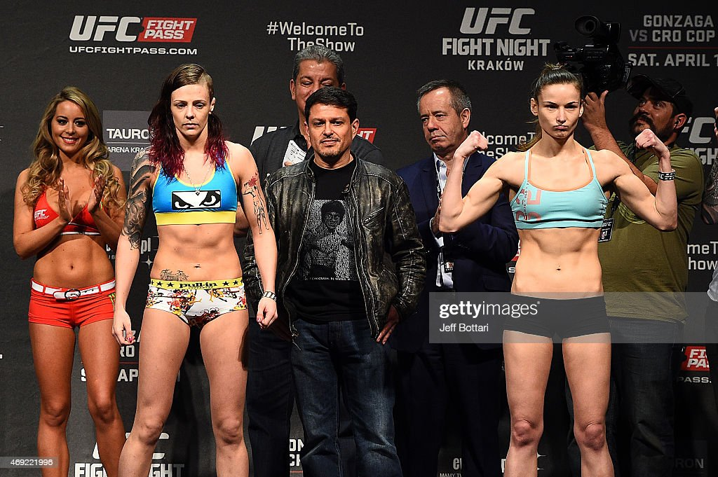 Joanne Calderwood of Scotland and Maryna Moroz of Croatia interact with the crowd after weighing in during the UFC Fight Night weigh-in at the Tauron Arena on April 10, 2015 in Krakow, Poland.