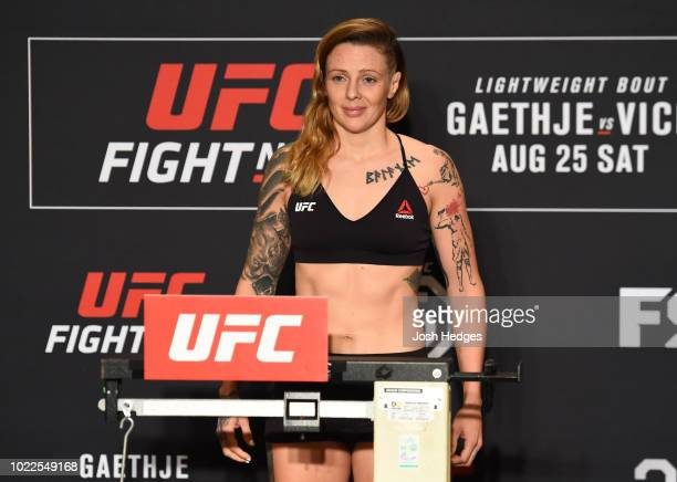 Joanne Calderwood of Scotland poses on the scale during the UFC weighin on August 24 2018 in Lincoln Nebraska