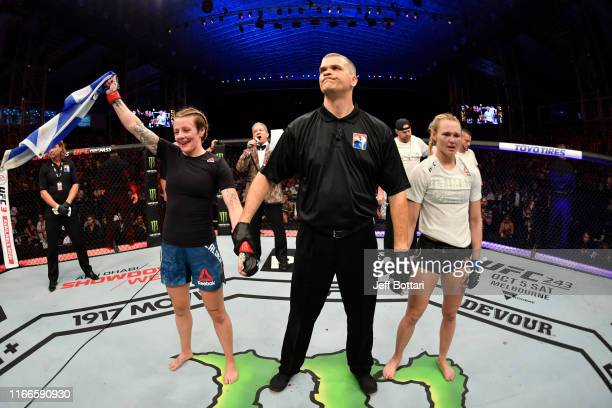 Joanne Calderwood of United Kingdom celebrates her victory over Andrea Lee in their women's flyweight bout during UFC 242 at The Arena on September 7...