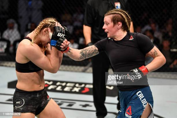Joanne Calderwood of United Kingdom punches Andrea Lee in their women's flyweight bout during UFC 242 at The Arena on September 7 2019 in Yas Island...