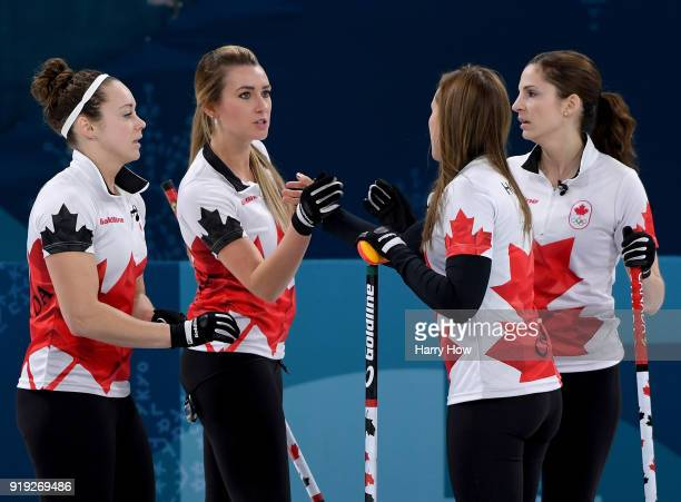 Joanne Courtney Emma Miskew Rachel Homan and Lisa Weagle of Canada celebrate a score against the United States during the Women's Curling Round Robin...