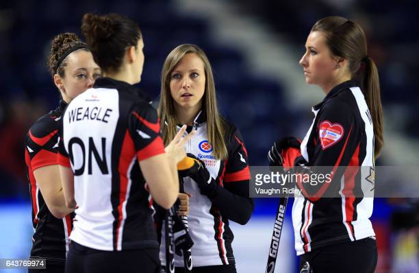 Joanne Courtney Lisa Weagle Rachel Homan and Emma Miskew of Ontario talk between ends in a draw eleven match against Newfoundland Labrador during the...