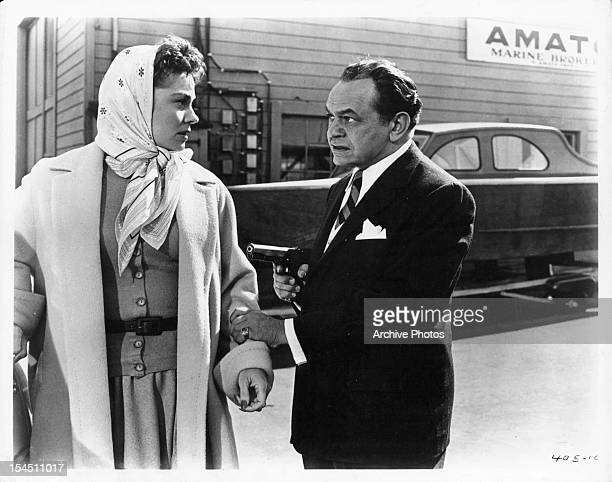 Joanne Dru is grabbed by Edward G Robinson in a scene from the film 'Hell On Frisco Bay' 1955