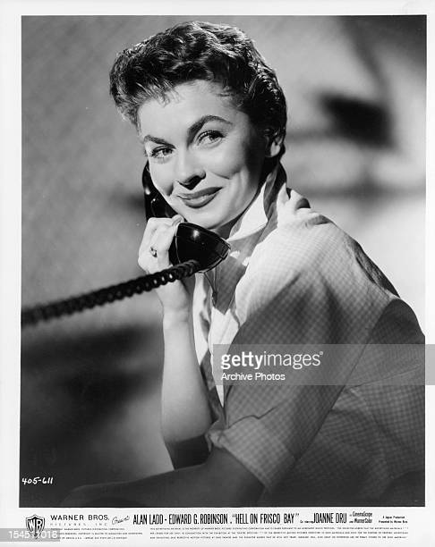 Joanne Dru on the phone in publicity portrait for the film 'Hell On Frisco Bay' 1955