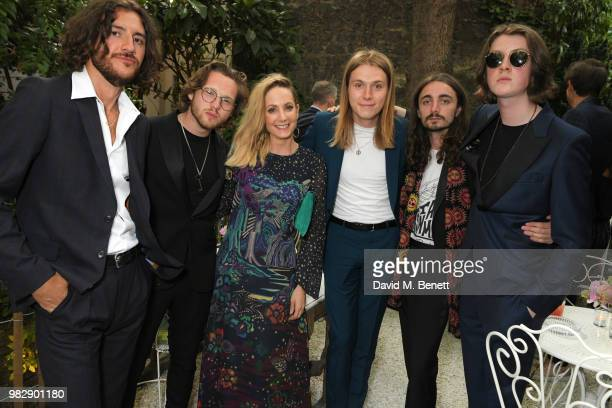 Joanne Froggatt poses with Charlie Salt Joe Donovan Myles Kellock Josh Dewhurst and Tom Ogden of Blossoms all wearing Paul Smith at the Paul Smith...
