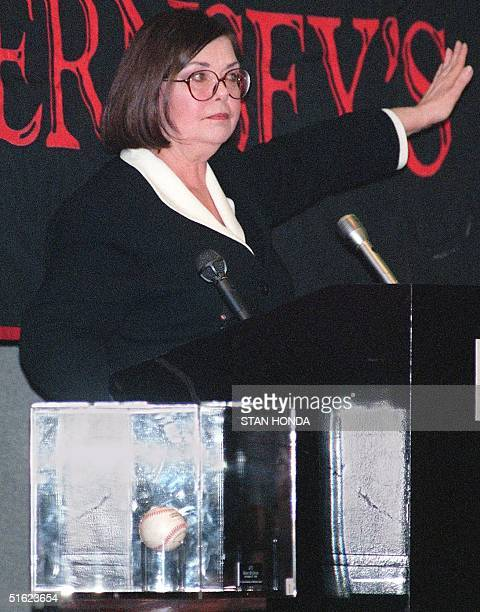 Joanne Grant of Gurnsey's Auction House takes bids for the 70th home run ball hit by St. Louis Cardinal slugger Mark McGwire 12 January at Madison...